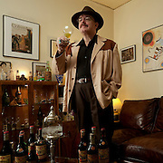 Jay Hendrickson is the world's leading authority on Legendre Herbsaint, the absinthe substitute created by J. Marion Legendre. He collects Herbsaint bottles and all related paraphenalia from the 1930s-1950s. Jay is responsible for the Original Herbsaint recipe being reintroduced and made available worldwide. Antique mini bottles he collected were used to chemically identify the &quot;original recipe&quot;.<br /> This image and a related story titled, &quot; The Informant&quot;, was published in the March/April 2010, Imbibe Magazine. <br /> Story by Robert Simonson <br /> Photos by Damian Hevia