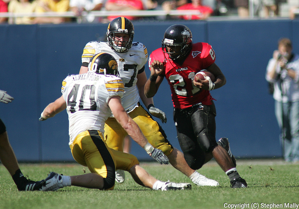 01 SEPTEMBER 2007: Northern Illinois tailback Justin Anderson (21) tries to avoid Iowa linebacker Mike Klinkenborg (40) in Iowa's 16-3 win over Northern Illinois at Soldiers Field in Chicago, Illinois on September 1, 2007.