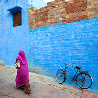 A Woman with Saree Walking By A Parked Black Bicycle in Jodhpur, Rajasthan, India