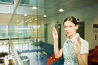 Woman Behind Glass Wall in office portrait