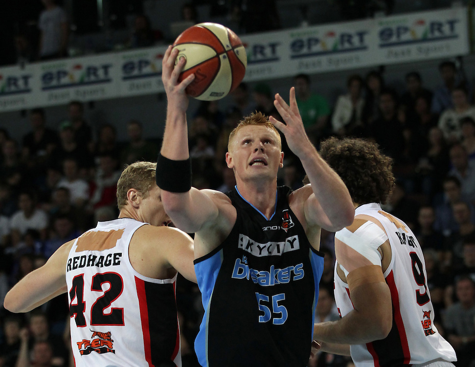 Breakers' Gary Wilkinson breaks through Wildcats' Shawn Redhage and Matthew Knight to take a shot in action against  in the first grand final of the ANBL Basketball Championship, Vector Arena, Auckland, New Zealand, Thursday, April 12, 2012.  Credit:SNPA / David Rowland