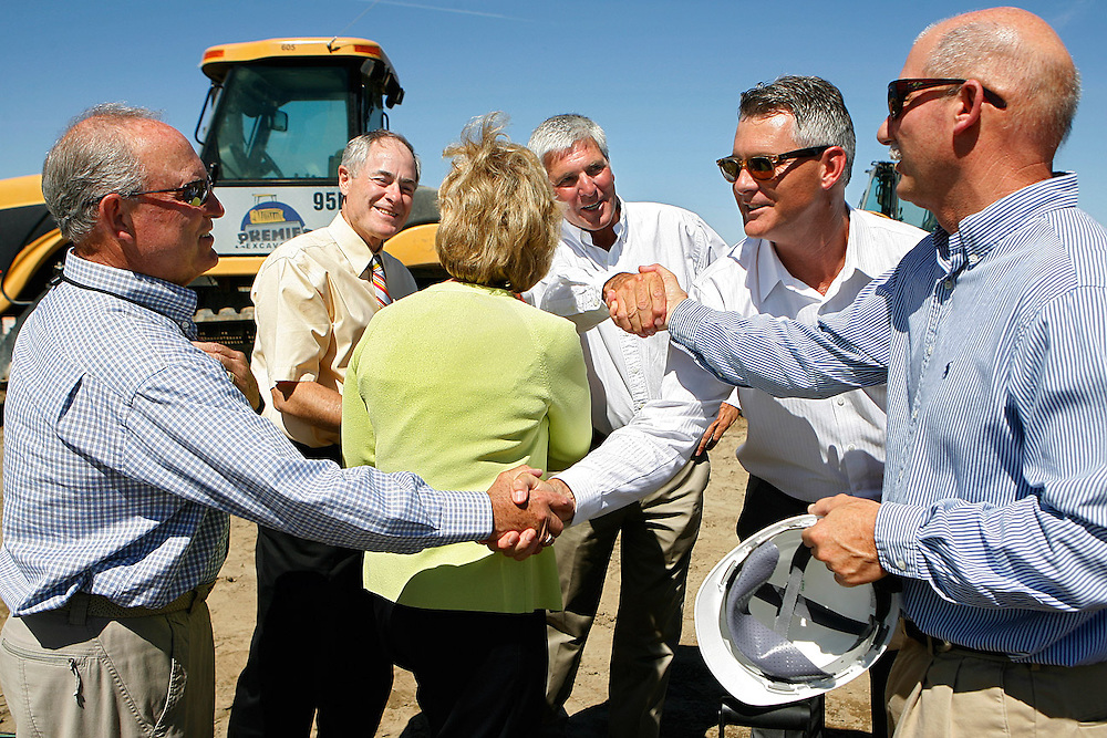Washington State Senator Mike Hewitt, left, State Representative Terry Nealey, Gov. Chris Gregoire, Walla Walla County Commissioner Perry Dozier, Ste. Michelle Wine Estates Vice President of Operations Rob McKinney and Railex Senior Vice President Jim Kleist all congratulate each other on Aug. 3, 2012 after a ground breaking ceremony for Railex's new 500,000-square-foot wine storage and distribution center in Burbank. The $18 to $20 million dollar project is expected to be completed February 2013.