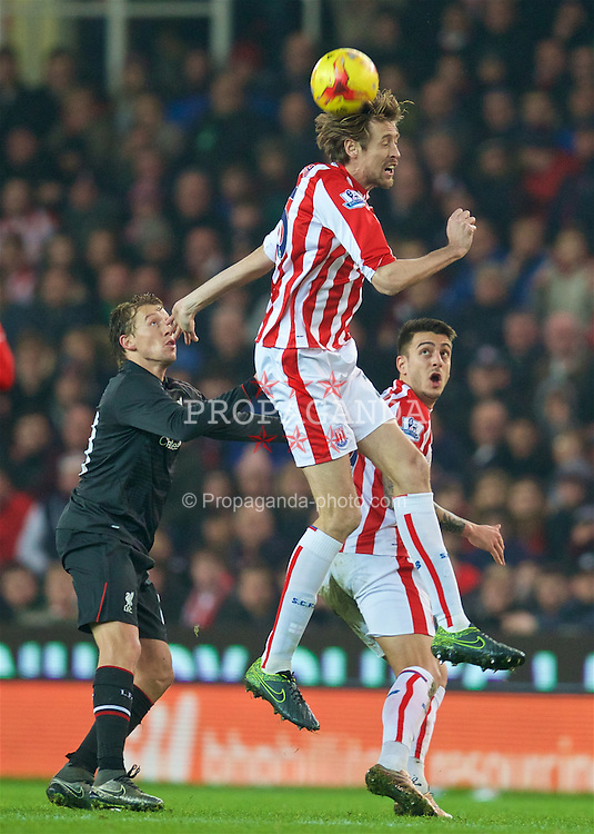 STOKE-ON-TRENT, ENGLAND - Tuesday, January 5, 2016: Stoke City's Peter Crouch in action against Liverpool during the Football League Cup Semi-Final 1st Leg match at the Britannia Stadium. (Pic by David Rawcliffe/Propaganda)