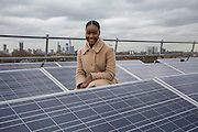 Victoria, a Re-powering intern. Brixton Energy Solar has installed several hundred square metres of solar panels on the roof of Elmore House in the Loughborough Estate in Brixton.<br /> Re-powering London, empower London communities to create their own renewable energy projects. London. UK