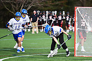 Lexington High School senior goalie Connor Dion stops the ball during the game against Winchester High School  in Lexington, April 24, 2018. Winchester won the game, 11-6.   [Wicked Local Photo/James Jesson]