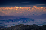 Morning light on east slope of the High Sierra over town of Bishop and Owens Valley, from the White Mountains, CALIFORNIA