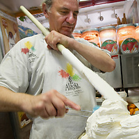 VENICE, ITALY - JUNE 30:  Carlo Pistacchi of Gelateria Alaska in Santa Croce prepares a batch of ananas ice cream on June 30, 2011 in Venice, Italy. Carlo has been making ice-cream using fresh ingredients for more than 25 years and is renowned for experimenting with new flavours, offering his customers classic favourites such as rum and raisin or chocolate as well as some of his more unconventional creations such as asparagus or rocket salad and orange.