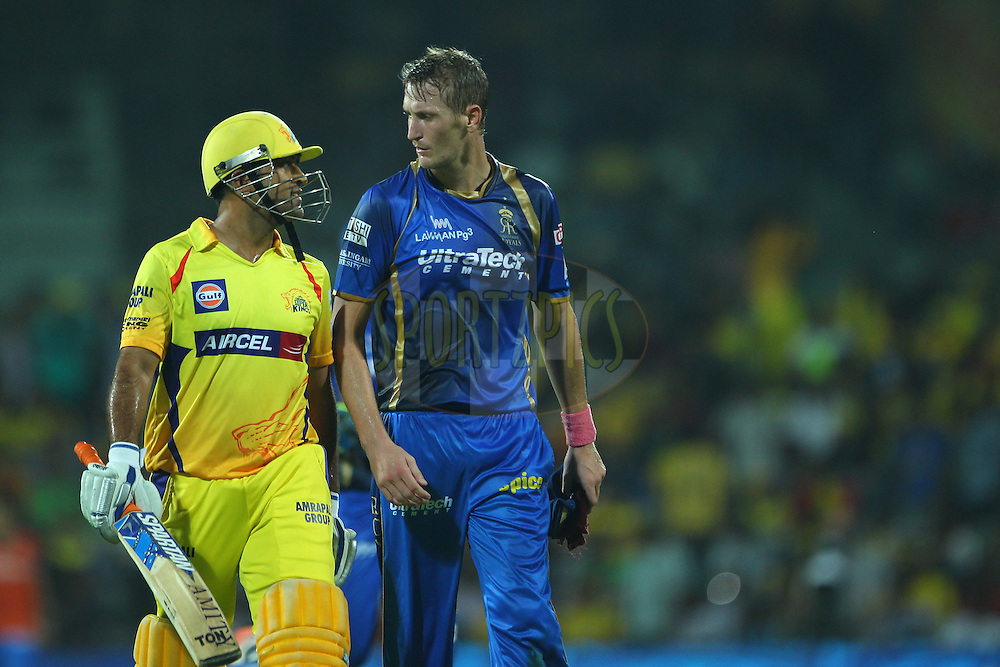MS Dhoni captain of the Chennai Superkings  and Christopher Morris of the Rajasthan Royals chat as they walk off after the CSK innings during match 47 of the Pepsi IPL 2015 (Indian Premier League) between The Chennai Superkings and The Rajasthan Royals held at the M. A. Chidambaram Stadium, Chennai Stadium in Chennai, India on the 10th May 2015.<br /> <br /> Photo by:  Ron Gaunt / SPORTZPICS / IPL
