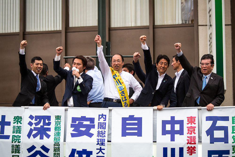 TOKYO, JAPAN - JULY 9 :  Japanese Prime Minister Shinzo Abe (Center Right), president of the ruling Liberal Democratic Party (LDP), candidate Masaharu Nakagawa (center) and the Liberal Democratic Party (LDP) members raised their fists to supporters after the campaign speech in the last day of Upper House election campaign outside of Asakusa Station in Tokyo, Japan on July 9, 2016. Tomorrow, July 10, 2016 will be the first Upper house election nation-wide in Japan that 18 years old can vote after government law changes its voting age from 20 years old to 18 years old. (Photo by Richard Atrero de Guzman/NURPhoto)