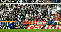 Photo. Jed Wee<br /> Newcastle United v Partizan Belgrade, European Champions League Qualifier, St. James' Park, Newcastle. 27/08/2003.<br /> Partizan's Milivoje Cirkovic (R) sends Newcastle goalkeeper Shay Given the wrong way to clinch the win.