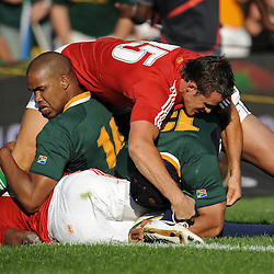 JP Pietersen and Adi Jacobs of the Springboks and Lee Byrne of the Lions competes for the ball on the tryline. during the British and Irish Lions tour 2009