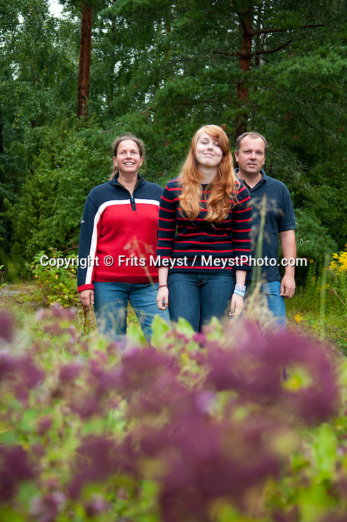 Kristinehamn, Sweden, August 2011. The Dutch Family Johan and Marise Sluiter, with their daughter Maren, moved to Sweden to find a new life. The region is covered with green forest, peat swamps and lakes and has more moose than people.  Photo by Frits Meyst/Adventure4ever.com