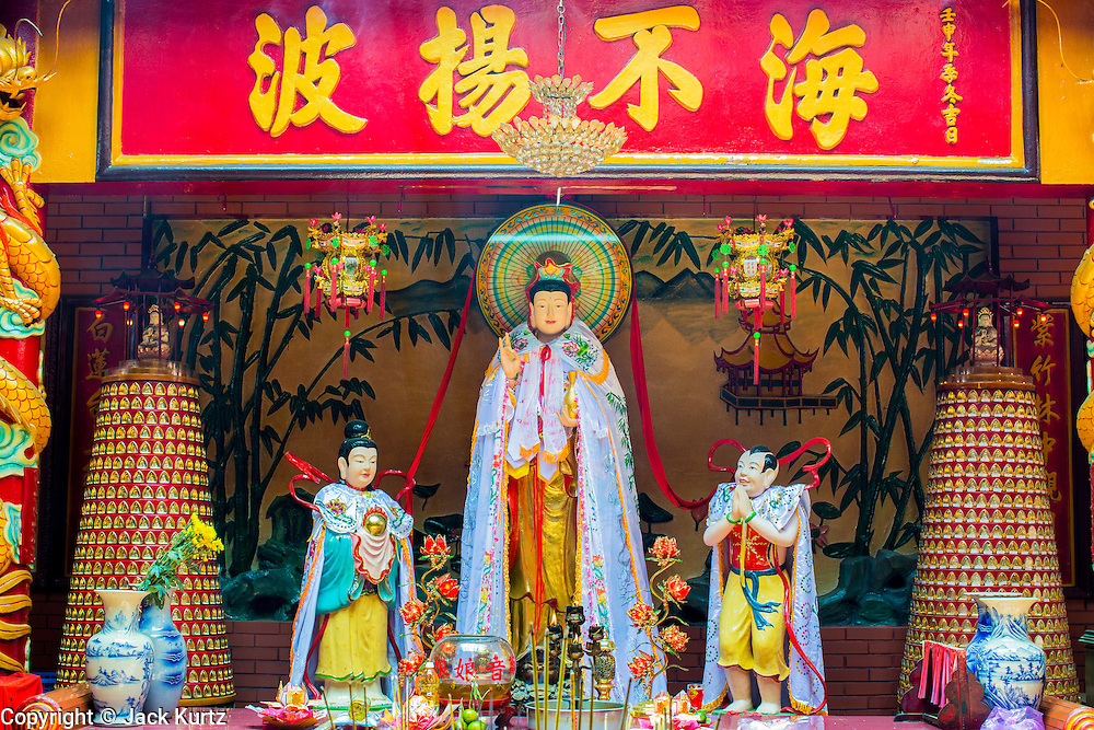 "12 APRIL 2012 - HO CHI MINH CITY, VIETNAM: An alter in Chùa Quan Âm (Avalokiteshvara Pagoda), a Chinese style Buddhist pagoda in Cho Lon. Founded in the 19th century, it is dedicated to the bodhisattva Quan Âm. The pagoda is very popular among both Vietnamese and Chinese Buddhists. Cholon is the Chinese-influenced section of Ho Chi Minh City (former Saigon). It is the largest ""Chinatown"" in Vietnam. Cholon consists of the western half of District 5 as well as several adjoining neighborhoods in District 6. The Vietnamese name Cholon literally means ""big"" (lon) ""market"" (cho). Incorporated in 1879 as a city 11 km from central Saigon. By the 1930s, it had expanded to the city limit of Saigon. On April 27, 1931, French colonial authorities merged the two cities to form Saigon-Cholon. In 1956, ""Cholon"" was dropped from the name and the city became known as Saigon. During the Vietnam War (called the American War by the Vietnamese), soldiers and deserters from the United States Army maintained a thriving black market in Cholon, trading in various American and especially U.S Army-issue items.          PHOTO BY JACK KURTZ"