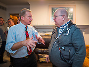 13 JANUARY 2020 - WEST DES MOINES, IOWA: TOM STEYER, left, talks to a man after speaking at a house party in West Des Moines Monday night. The main issue was climate change, which Steyer has said is his top priority. Steyer, a California businessman, is campaigning to be the Democratic nominee for the US Presidency in 2020. Iowa holds the first selection event of the 2020 election cycle. The Iowa Caucuses are Feb. 3, 2020.              PHOTO BY JACK KURTZ