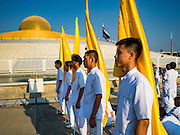 "11 FEBRUARY 2016 - KHLONG LUANG, PATHUM THANI, THAILAND: People walk into the pagoda during the Makha Bucha Day service at Wat Phra Dhammakaya.  Makha Bucha Day is a public holiday in Cambodia, Laos, Myanmar and Thailand. Many people go to the temple to perform merit-making activities on Makha Bucha Day, which marks four important events in Buddhism: 1,250 disciples came to see the Buddha without being summoned, all of them were Arhantas, or Enlightened Ones, and all were ordained by the Buddha himself. The Buddha gave those Arhantas the principles of Buddhism. In Thailand, this teaching has been dubbed the ""Heart of Buddhism."" Wat Phra Dhammakaya is the center of the Dhammakaya Movement, a Buddhist sect founded in the 1970s and led by Phra Dhammachayo. Makha Bucha Day is one of the most important holy days on the Thai Buddhist calender.      PHOTO BY JACK KURTZ"