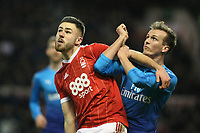 Arsenal's Rob Holding (R) locks horns with Forest's Ben Brereton  during The Emirates FA Cup Third Round match between Nottingham Forest and Arsenal at City Ground on January 7, 2018 in Nottingham, England.