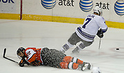 2012/03/16 - RIT's Adam Hartley falls while Niagara's Patrick Divjak takes control of the puck during the Atlantic Hockey semifinal at the Blue Cross Arena in Rochester, N.Y. on March 16th, 2012. RIT defeated Niagara 2-1 in overtime.