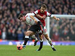 Liverpool's Joe Allen and Arsenal's Mathieu Flamini battle for the ball - Photo mandatory by-line: Matt Bunn/JMP - Tel: Mobile: 07966 386802 16/02/2014 - SPORT - FOOTBALL - Emirates Stadium - London - Arsenal v Liverpool - FA Cup - Fifth Round