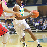 UNCW's Freddie Jackson Drives against Liberty's Andrew Smith Wednesday December 17, 2014 at Trask Coliseum on the campus of UNCW in Wilmington, N.C. (Jason A. Frizzelle)