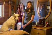 Brianne Barry and her dog, Ginger, in Brianne's childhood bedroom in Queens on Sept. 21. (Photo by Emily Field)