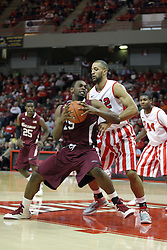 02 February 2013: Dantiel Daniels works against Jackie Carmichael during an NCAA Missouri Valley Conference mens basketball game where the Salukis of Southern Illinois lost to the Illinois State Redbirds for Retro-Night 83-47 in Redbird Arena, Normal IL