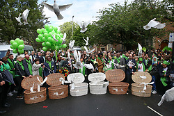 © Licensed to London News Pictures. 14/06/2019. London, UK.  72 white doves are released by survivors, family and friends of the victims following a service is held at St Helen's Church in North Kensington to commemorate the second anniversary of the Grenfell Tower fire. On 14 June 2017, just before 1:00am a fire broke out in the kitchen of the fourth floor flat at the 24-storey residential tower block in North Kensington, West London, which took the lives of 72 people. More than 70 others were injured and 223 people escaped. Photo credit: Dinendra Haria/LNP