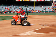 ANAHEIM - APRIL 10:  A groundskeeper in a motorized vehicle rakes the infield dirt prior to the game between the Toronto Blue Jays and the Los Angeles Angels of Anaheim at Angel Stadium in Anaheim, California on Sunday April 10, 2011. The Angels won the game 3-1. (Photo by Paul Spinelli/MLB Photos via Getty Images)