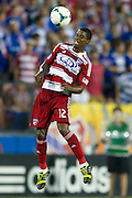 FRISCO, TX - AUGUST 11:  Erick #12 of FC Dallas heads the ball against the Los Angeles Galaxy on August 11, 2013 at FC Dallas Stadium in Frisco, Texas.  (Photo by Cooper Neill/Getty Images) *** Local Caption *** Erick