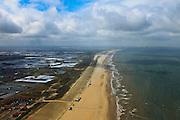 Nederland, Zuid-Holland, Gemeente Westland,  22-05-2011; Noordzeestrand en kust bij Ter Heijde en Monster, gezien naar Hoel van Holland en de Maasvlakte. Links de kassen van het Westland..Omdat de kustverdediging tot voor kort uit slechts een duinenrij bestond was dit een van de Zwakke Schakels van de Kust. De duinenrij is inmiddels verstrekt door aan de zeezijde door middel van zandsuppletie een zanddijk aan te leggen. Deze zanddijk is inmiddels beplant met helm. .North sea beach at Ter Heijde. .This coastline was know as one of the 'weak links' in the coastal defense because the dunes were only one row thick and not very strong. The coast has been  strengthened by means of sand supplementation, creating a sand dike before the dunes. This dike has been planted with marram grass.luchtfoto (toeslag), aerial photo (additional fee required).copyright foto/photo Siebe Swar