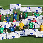 Glasgow 2014 chief executive David Grevemberg and Glasgow School of Sport pupils launch the 'Final Sprint' ticket promotion at The National Hockey Centre, GLASGOW. 2 May 2014. (c) Paul J Roberts / StockPix.eu