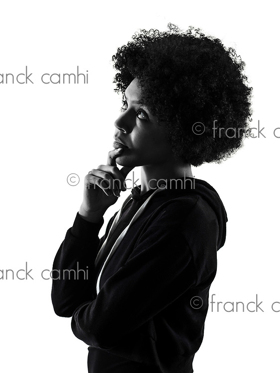 one mixed race african young teenager girl woman looking up thinking  in studio shadow silhouette isolated on white background
