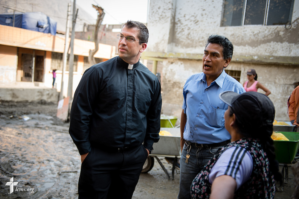The Rev. Ross Johnson, LCMS director of Disaster Response, surveys mud cleanup from a street near Lima, Peru, on Tuesday, April 7, 2015. Heavy rains in March caused massive avalanches of mud and rocks in several regions, killing residents, displacing others, and causing infrastructure destruction. LCMS Communications/Erik M. Lunsford