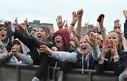 © Licensed to London News Pictures.16/06/2012. Stoke on Trent England . Festival goers at the Stoke 2012 live music festival,brave the poor weather conditions.  : Rob Leyland/LNP