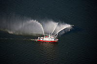 Aerial Photo of Baltimore City Fireboat doing water display during inaugural sail of Carnival Pride sail to Maryland