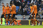 Wolverhampton Wanderers striker Benik Afobe (10) is congratulated after the Brighton central defender, Connor Goldson (17) own goal during the Sky Bet Championship match between Brighton and Hove Albion and Wolverhampton Wanderers at the American Express Community Stadium, Brighton and Hove, England on 1 January 2016. Photo by Phil Duncan.