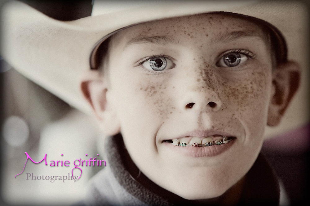 Young cowboy guest at Kemper wedding in Loveland, CO. Photographed by: Marie Griffin Photography on June 12, 2010.