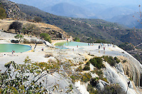 "Mineral springs fill the swimming pools at Hierve el Agua, then tumble down the cliff face to form ""petrified waterfalls."""