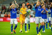 Hamza Choudhury (#20) of Leicester City congratulates Kasper Schmeichel (#1) of Leicester City after Leicester win the penalty shoot-out of the EFL Cup match between Newcastle United and Leicester City at St. James's Park, Newcastle, England on 28 August 2019.