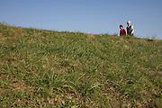 elderly couple walking over a dike