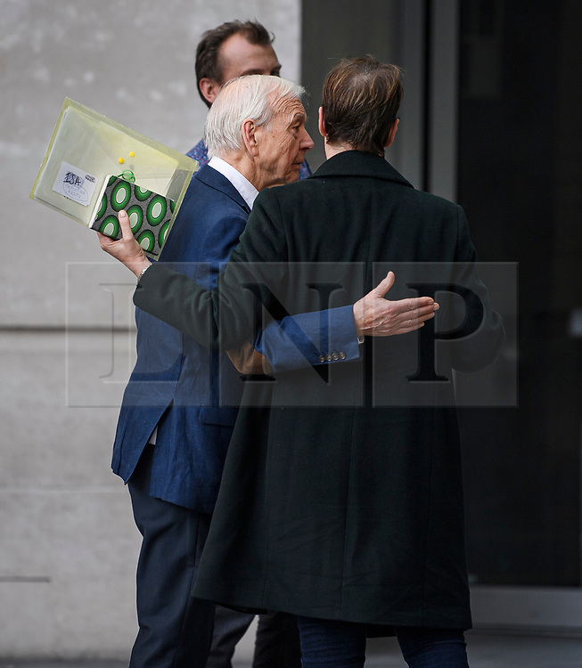 © Licensed to London News Pictures. 19/09/2019. London, UK. Veteran broadcaster JOHN HUMPHRYS is seen being embraced by a colleague as he leaves BBC Broadcasting House in London following his final day on the BBC Radio 4 Today Programme. Photo credit: Ben Cawthra/LNP