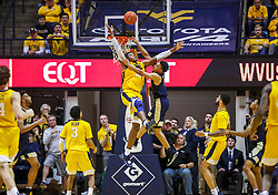 Dec 8, 2018; Morgantown, WV, USA; West Virginia Mountaineers forward Sagaba Konate (50) blocks a dunk from Pittsburgh Panthers guard Trey McGowens (2) during the second half at WVU Coliseum. Mandatory Credit: Ben Queen-USA TODAY Sports