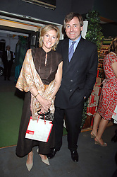 WILLIAM & CAROLYN BARTHOLOMEW at a party for the Royal Marsden Hospital held at the Chelsea Gardener, Sydney Street, London on 6th May 2008.<br />