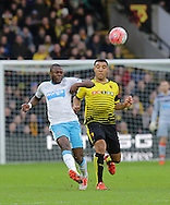 Chancel Memba clears from Troy Deeney during the The FA Cup Third Round match between Watford and Newcastle United at Vicarage Road, Watford, England on 9 January 2016. Photo by Dave Peters.