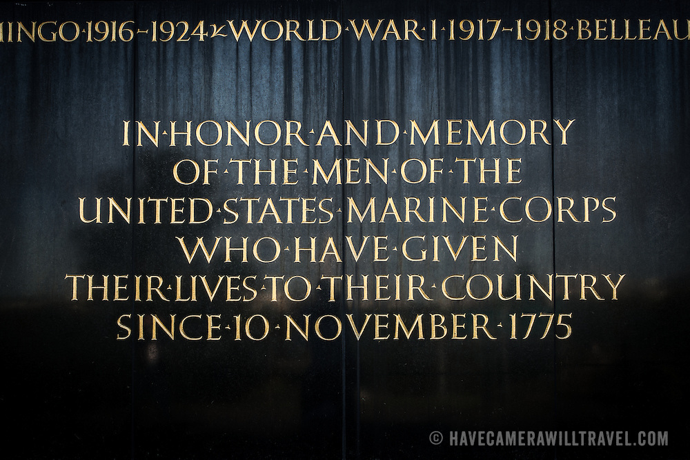 Dedication inscription on the base of the Iwo Jima Memorial (formally the Marine Corps War Memorial) in Arlington, Virginia, next to Arlington National Cemetery. The monument was designed by Felix de Wledon and is based on an iconic Associated Press photo called the Raising the Flag on Iwo Jima by Joe Rosenthal. It was dedicated in 1954.