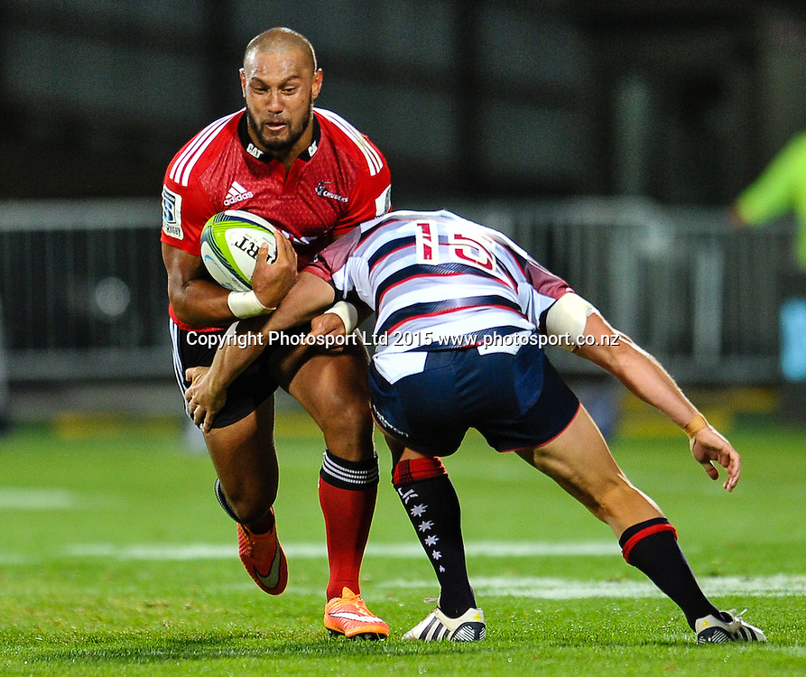 Robbie Fruean of the Crusaders is tackled byMike Harris of the Rebels in the Super Rugby match, Crusaders v Rebels at AMI Stadium, Christchurch, New Zealand 13 February 2015. Photo:John Davidson/www.photosport.co.nz