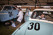 Mechanics carry out work on their vintage vehicles at the  Goodwood Revival in Chichester, England Friday, Sept. 9, 2016 The historic motor racing festival celebrates the mid-20th-century golden era of the racing circuit and recreates the atmosphere from the 1950s and 1960s.(Elizabeth Dalziel)