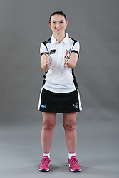 Umpire Jenny Fissenden signalling obstruction of player with ball