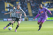Notts County defender Gill Swerts closed down by Plymouth Argyle forward Reuben Reid  during the Sky Bet League 2 match between Notts County and Plymouth Argyle at Meadow Lane, Nottingham, England on 11 October 2015. Photo by Simon Davies.