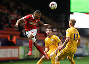 Charlton Athletic defender Tareiq Holmes-Dennis wins a header during the Sky Bet Championship match between Charlton Athletic and Preston North End at The Valley, London, England on 20 October 2015. Photo by David Charbit.