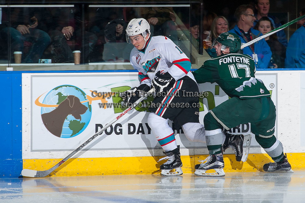 KELOWNA, CANADA - JANUARY 08: Nick Merkley #10 of Kelowna Rockets keeps ahead of a hit by Matt Fonteyne #17 of Everett Silvertips on January 8, 2016 at Prospera Place in Kelowna, British Columbia, Canada.  (Photo by Marissa Baecker/Shoot the Breeze)  *** Local Caption *** Nick Merkley; Matt Fonteyne;
